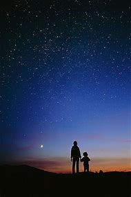 Child Looking Up at Night Sky