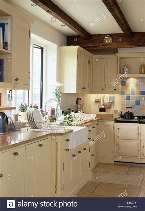 Belfast Sink Below Window In Country Cottage Kitchen With