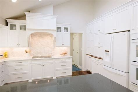 backsplash white kitchen the granite gurus calacatta gold marble