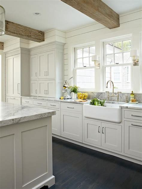 light gray kitchen  rustic wood ceiling beams