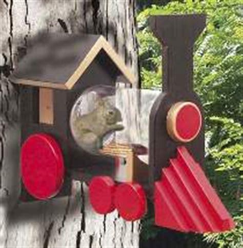 wooden     squirrel feeder   gallon jar