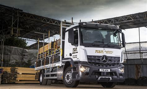 scaffolding firm reaches  heights  mercedes benz
