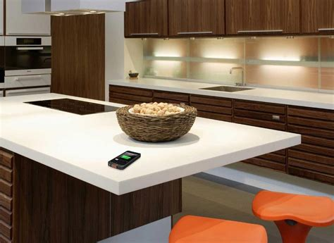 corian countertops wirelessly charge your device on dupont corian tabletops