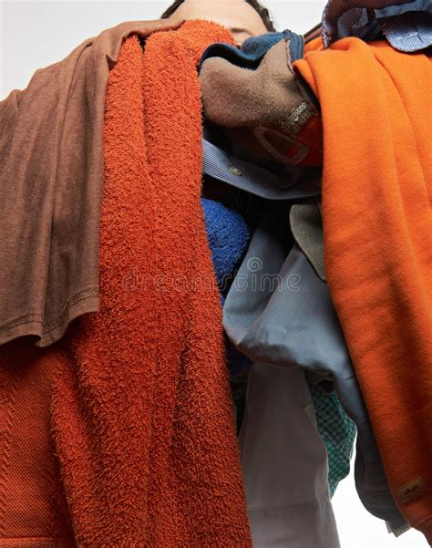 untidy cluttered woman wardrobe  colorful clothes