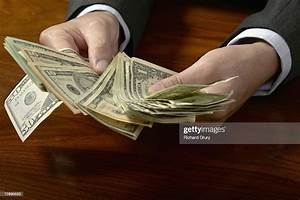 Businessman Counting Money On Desk Close Up Closeup Stock
