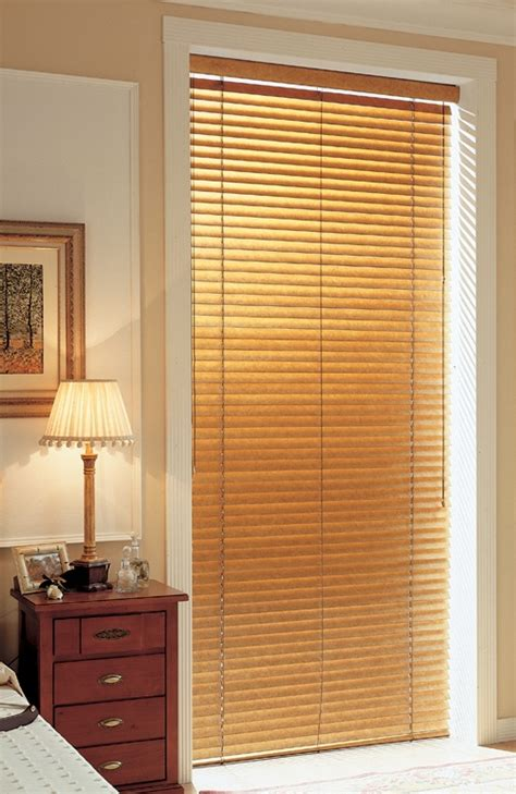 wood blinds on a patio door venecianas de madera