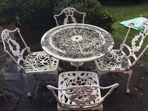 white metal garden table and chairs in banstead surrey
