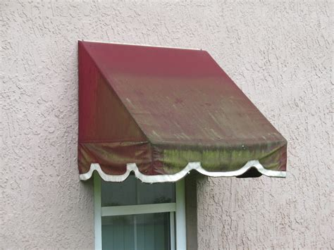 Black Awnings With Green Mold And Lichen!