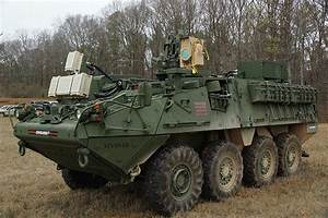 U.S. soldiers ready to use laser weapon MEHEL mounted on ...