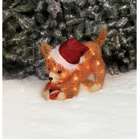 holiday time christmas decor  fluffy cat hold ornament