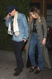 Johnny Depp keeps a low profile alongside his stylish wife ...