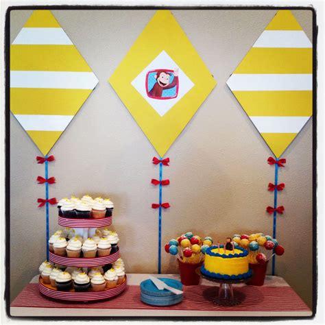 curious george yellow  white kites  cake table