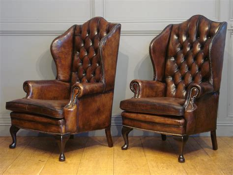 Soldpair Of Antique Leather Wing Armchairs Antique