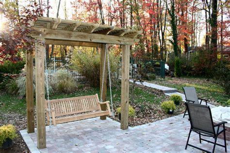 a custom patio a swing pergola a flower planter work