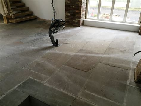 recently installed yorkstone tiles cleaned and sealed in