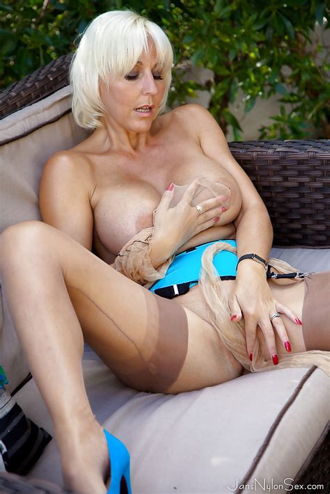 busty blonde dame jan burton removes pantyhose for outdoor masturbation