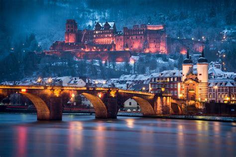 black canvas heidelberg castle and brige in winter andreas