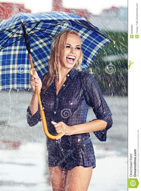 girl  umbrella watching  rain stock image image