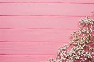 Pink wooden background with floral decoration Photo | Free ...