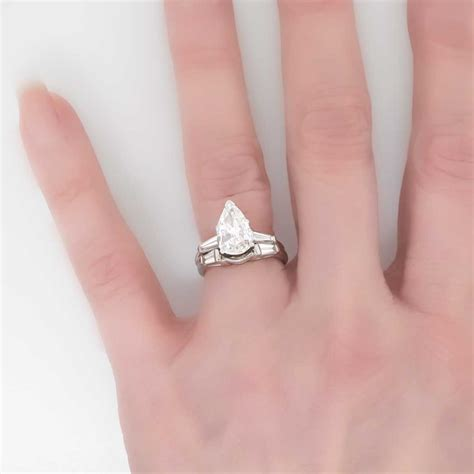 pear shaped engagement ring with baguettes wedding and