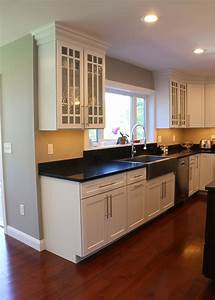 White Kitchen Featuring Dark Cherry Island