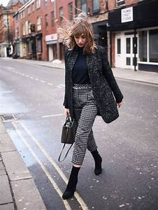 Picture Of a black turtleneck a long tweed jacket plaid cropped pants and black sock boots