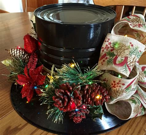 coffee can crafts top hat centerpieces made from tin coffee can and a record with ribbon and holiday picks