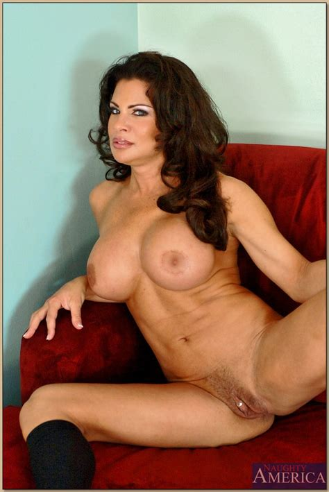 Erogenous Milf Teri Weigel Like To Pose On A Red Couch