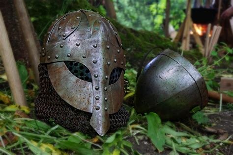 black steel helmet  black  gray handle sword