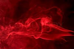 Abstract background showing some red smoke in black back ...