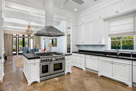 luxury chefs kitchen  double oven island  white
