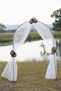 Gorgeous ceremony arch decorated with tulle and king for Decorating a trellis for a wedding