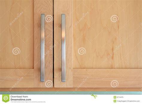 Maple doors and handles stock image. Image of doors