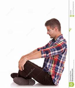 Young Man Sitting Looking Down Stock Photo - Image of ...