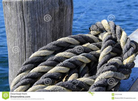 Big Boat Rope by Thick Knotted Rope At The Boat Dock Royalty Free Stock