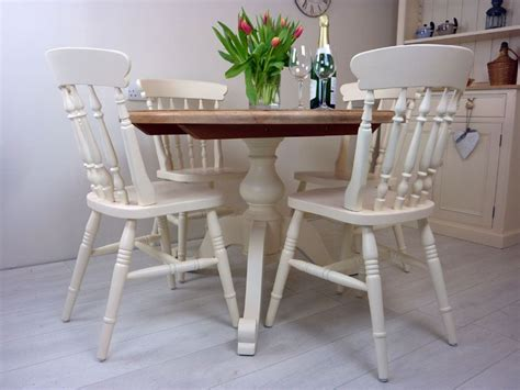 pine pedestal table and 4 farmhouse chairs painted