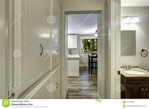 Small Walk through With Built in Cabinets And Exit To