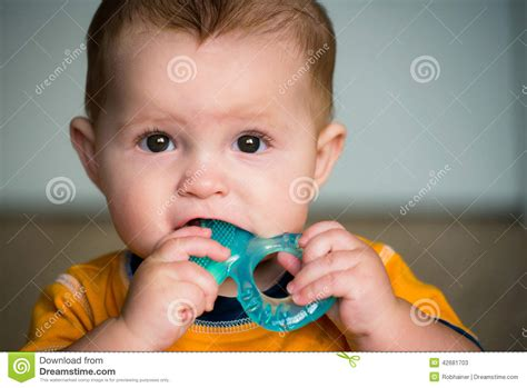 Baby Chewing On Teething Ring Stock Photo Image 42681703