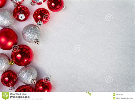 many christmas ornaments in the snow royalty free stock
