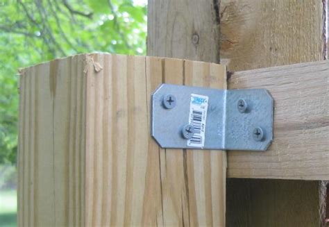 How To Attach Stockade Fence To Wood Posts?