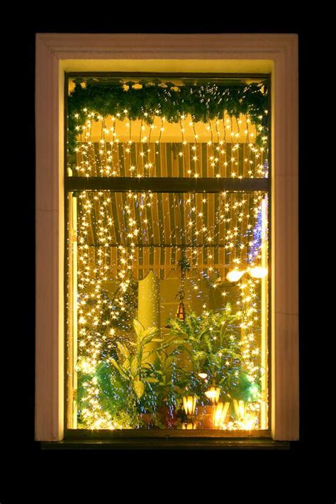 how to hang christmas lights inside windows christmas window decoration ideas slideshow