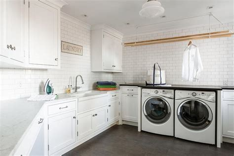 white pull out kitchen faucet large cottage laundry room with two gray barn doors on
