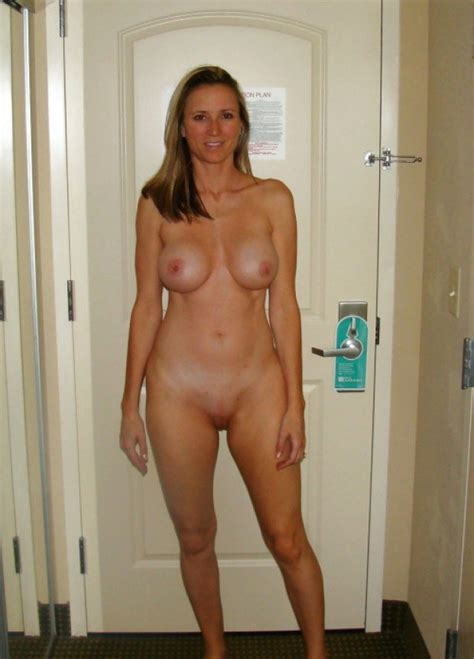 superb blonde is naked in the hotel room