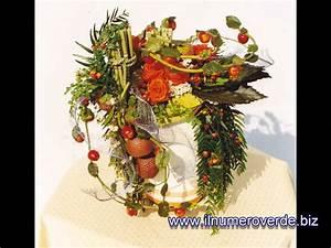 Composizioni floreali con fiori freschi e artificiali