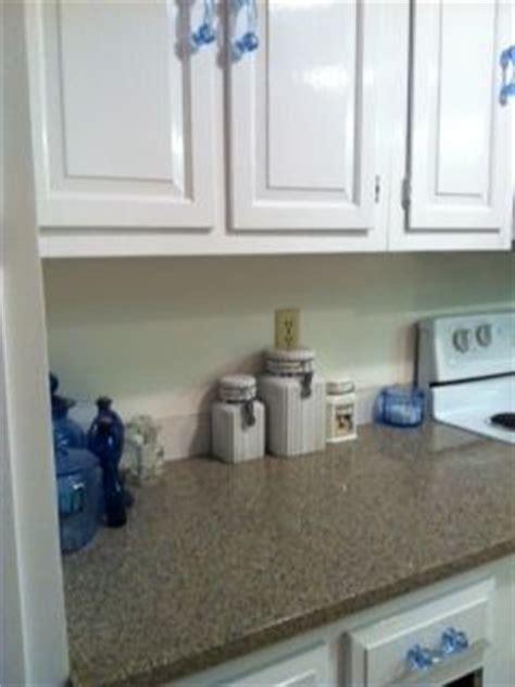 Silestone Quartz Blue Sahara and white cabinets