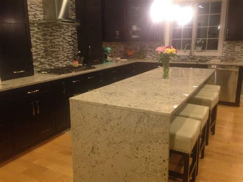 granite kitchen counter tops and island with waterfall