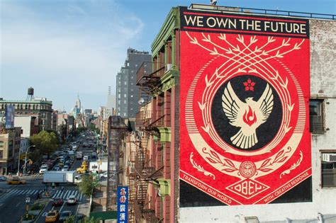 we own the future mural up in lower east side nyc obey