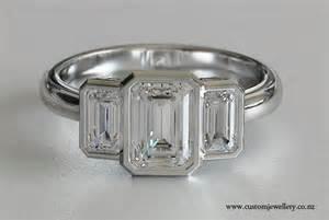 emerald cut three engagement ring emerald cut three bezel set engagement ring new zealand