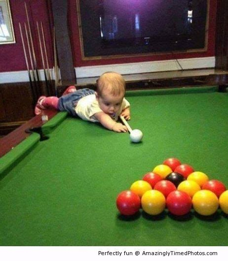 Baby learns to play pool – It takes learning to master the ...