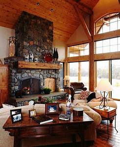 Living Room With River Rock Stone Fireplace And Pine Wood